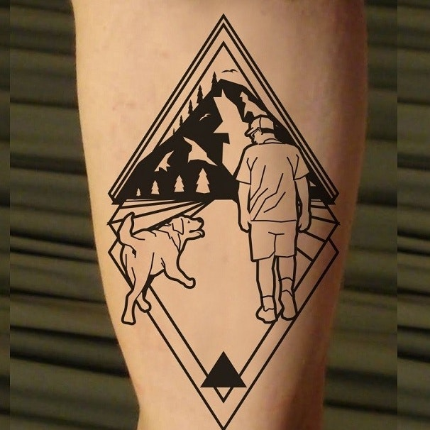 Man and dog tattoo
