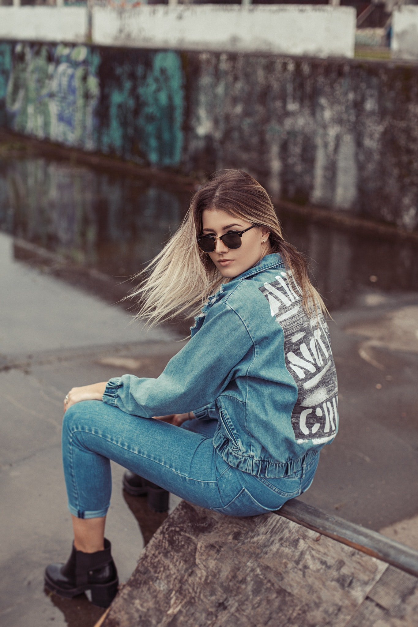 Woman wearing denim jacket and sunglasses