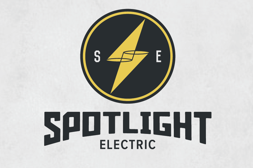 "round logo with a yellow lighting bolt made of two cones and the text ""spotlight electric"""
